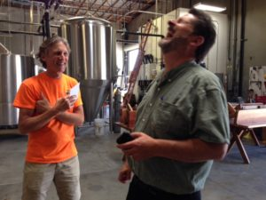 Kurt is showing Jeff around the brewery