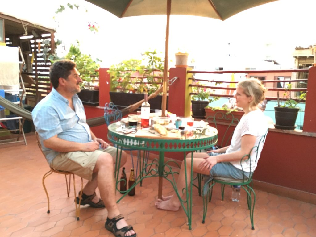 Jeff and Joeri, a sweet Dutch girl we meet at the Airbnb enjoying a picnic meal on the rooftop patio